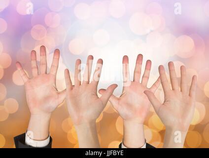Digital composite of Many open Hands with sparkling light bokeh background - Stock Photo