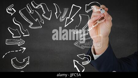 Digital composite of Hand drawing white arrow doodles against grey wall - Stock Photo