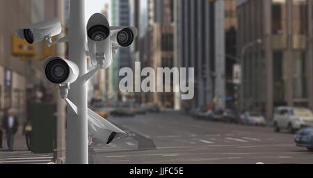 Digital composite of CCTV cameras against roads in city - Stock Photo