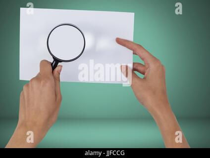 Digital composite of Holding magnifying glass over blank card - Stock Photo