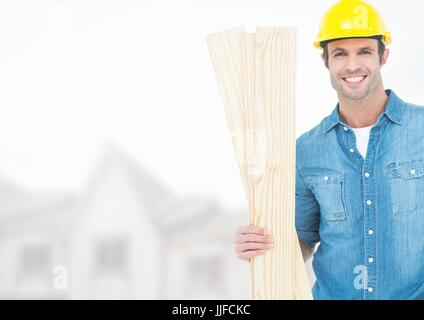 Digital composite of Carpenter with wood on building site - Stock Photo