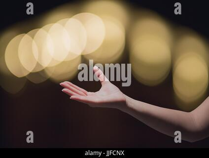 Digital composite of Hand reaching asking in wonder with sparkling light bokeh background - Stock Photo