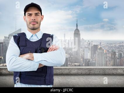 Digital composite of Security guard with arms folded against skyline - Stock Photo