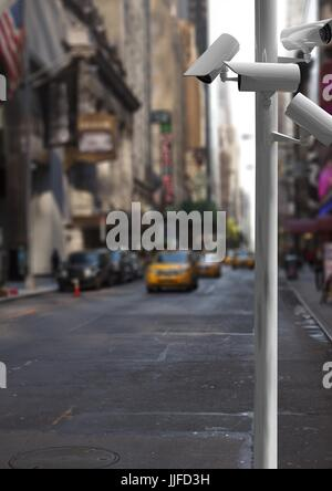 Digital composite of cctv stick in the road, taxi behind it - Stock Photo