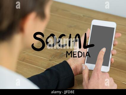 Digital composite of Social media text against woman over shoulder touching phone - Stock Photo