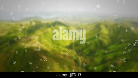 Digital composite of White network against green blurry mountains - Stock Photo