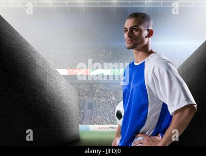 Digital composite of soccer player prepare to go out to the field - Stock Photo