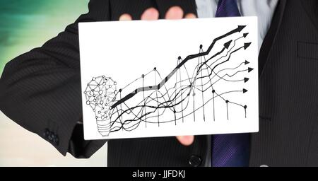 Digital composite of Business man mid section with card showing lightbulb and graph doodle against blurry green - Stock Photo