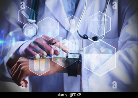Mid section of female doctor using smart watch against medical icons in hexagons interface menu - Stock Photo