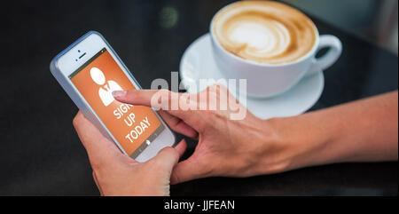 Vector image of Sign Up Now text with human icon  against woman having coffee and using her phone - Stock Photo