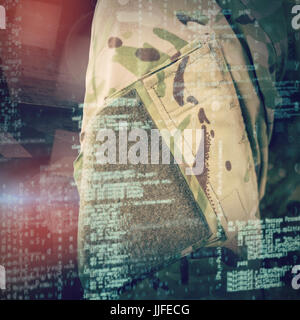Mid section of soldier in uniform against abstract room - Stock Photo