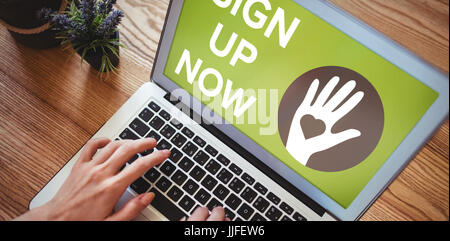 Sign Up Now text with icons on green screen against hands of woman using laptop - Stock Photo