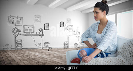 Beautiful young woman sitting on couch  against doodle office in hallway - Stock Photo