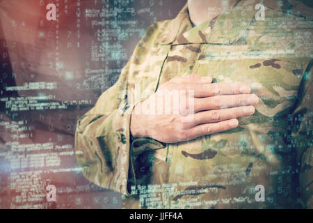 Mid section of soldier in uniform taking oath against abstract room - Stock Photo
