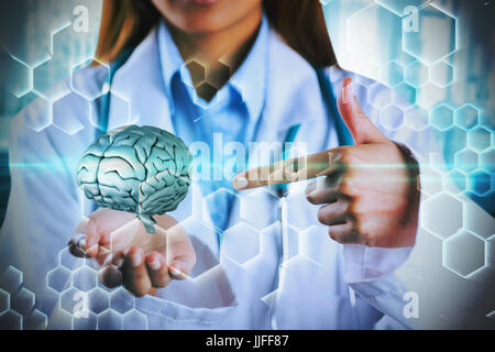 Mid section of female doctor showing empty hand against chemical structure in blue and black - Stock Photo