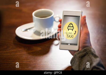 Vector image of Taxi calling text with icon  against hand holding mobile phone - Stock Photo