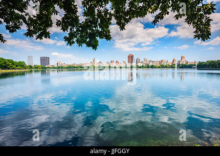 New York Central Park, sky reflection in to lake Jacqueline Kennedy Onassis Reservoir - Stock Photo