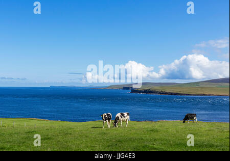View from the A966 on the northern coast of Mainland looking towards Rousay with Westray in the distance, Orkney, - Stock Photo
