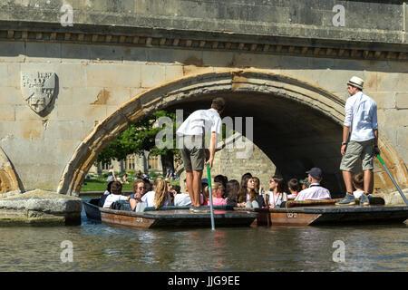 Punters going under Trinity bridge on river Cam, Cambridge, England UK - Stock Photo
