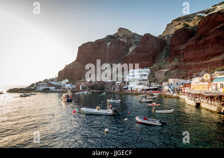 Amoudi, Santorini island, Greece. Amoudi bay is located below Oia village. Boats and taverns near the water. - Stock Photo