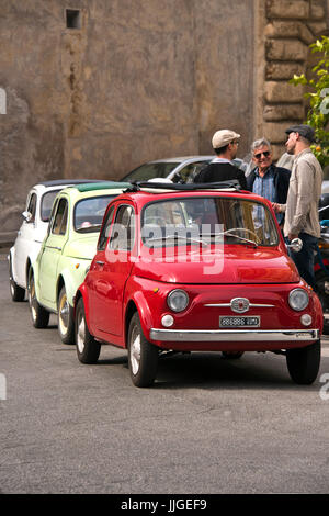 Vertical view of three classic Fiat 500's parked in a row. - Stock Photo