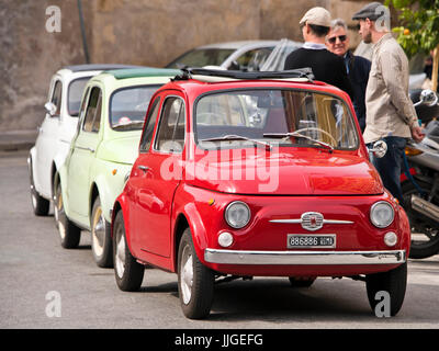 Horizontal view of three classic Fiat 500's parked in a row. - Stock Photo
