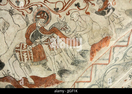 Danish medieval religious fresco in the 13th century Gothic style Tuse Church depicting Saint Martin of Tours  sharing - Stock Photo