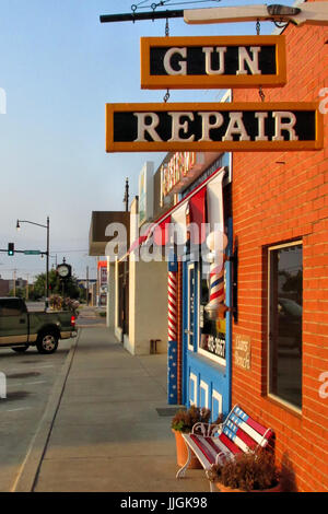 Patriotic colors adorn store fronts on the main street of Moore Oklahom. - Stock Photo