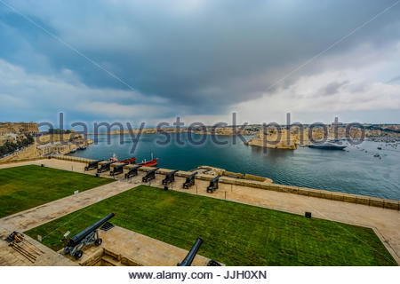 Saluting battery cannons guarding the harbor and city of Valletta on the mediterranean island of Malta - Stock Photo