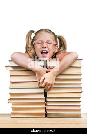 Girl leaned on piles of books - Stock Photo