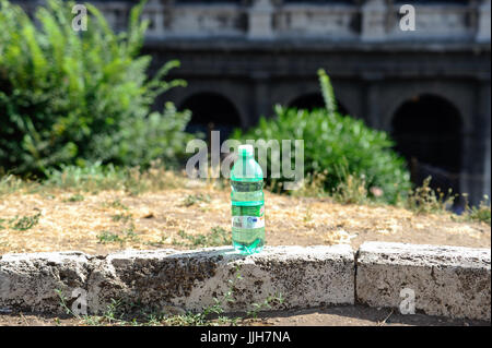 Abandoned plastic water bottle on the city - Stock Photo