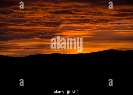 Sunrise clouds and mountains in Guatemala, dramatic sky with striking colors. - Stock Photo