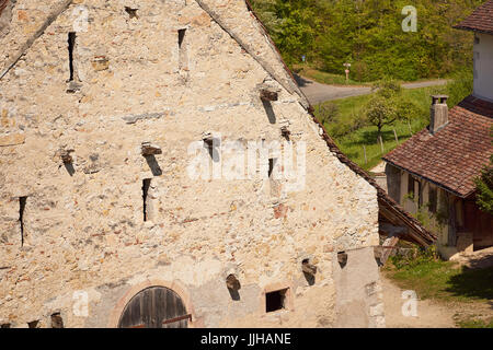 Medieval ancient facade of a Birseck castle house in Arlesheim village - near Basel, Baselland Kanton, Switzerland - Stock Photo