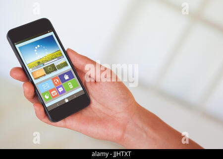 Womans hand holding black smartphone against vector image of various video and icons - Stock Photo