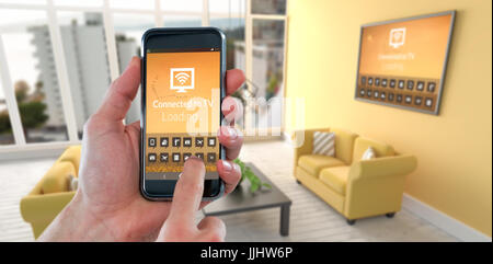 Cropped hand using mobile phone against digital image of modern living room - Stock Photo