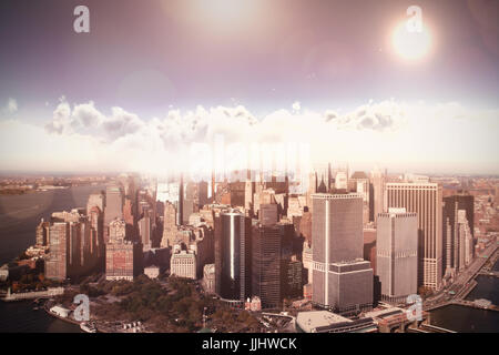 Scenic view of sun over cloudscape during sunny day against one world trade center in city by river on sunny day - Stock Photo