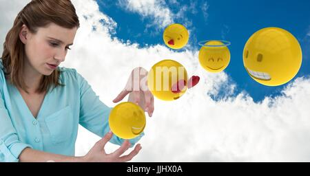 Digital composite of businesswoman with 3d emojis against cloudy sky - Stock Photo