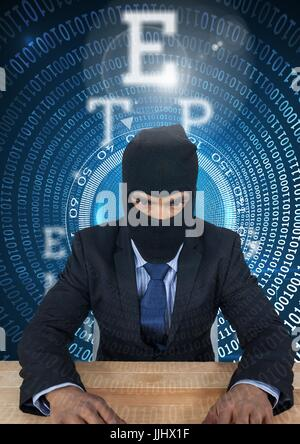 Hacker using a laptop in  a data center - Stock Photo