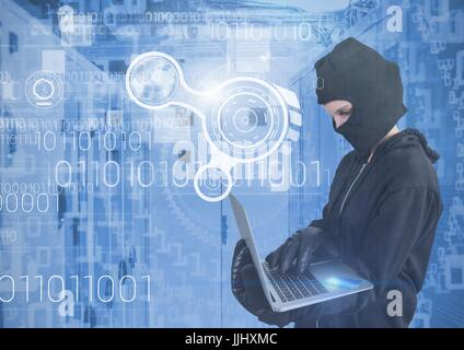 Woman hacker with hood using a laptop in data center - Stock Photo
