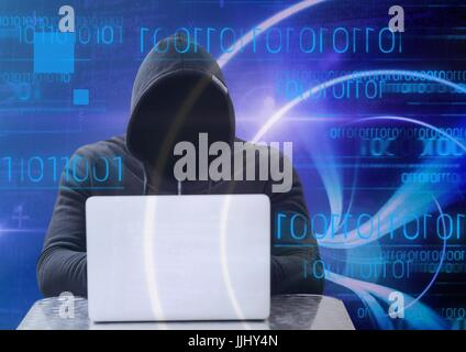 Shadow of hacker with sweatshirt using a laptop in front of blue digital background - Stock Photo