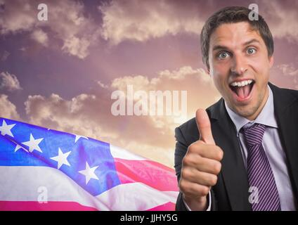 Business man with thumbs up against sunset and 3D american flag - Stock Photo