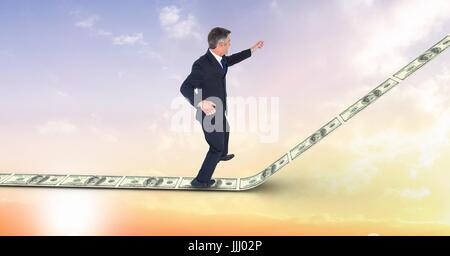 Digital composite image of businessman standing on 3d money walkway - Stock Photo
