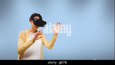 3d Woman wearing virtual reality headset - Stock Photo
