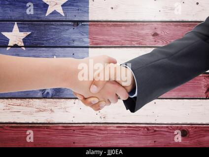 Business people shanking their hands against american flag - Stock Photo