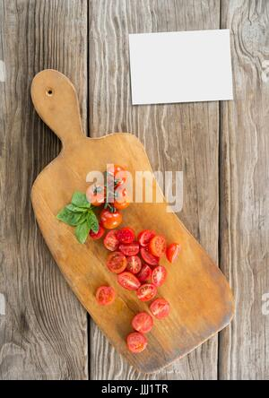Bussiness card on wooden desk with food and copy space - Stock Photo