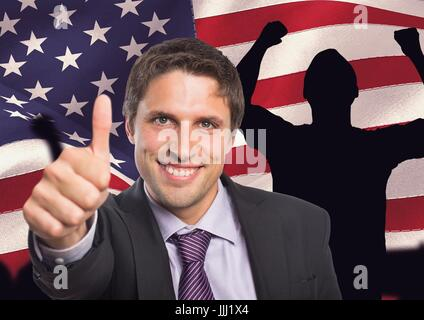 Business man with thumbs up against american flag - Stock Photo