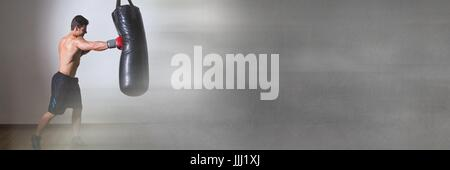 Boxer fighter man punching bag with grey copy space transition - Stock Photo