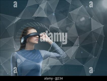 Woman in VR headset looking to an interface against blue sky - Stock Photo