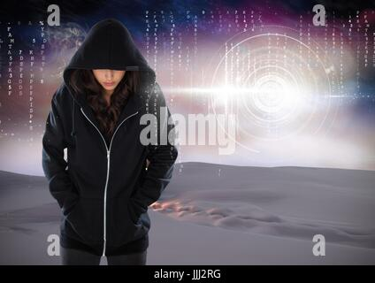 Woman hacker hooded standing on in front of digital background - Stock Photo