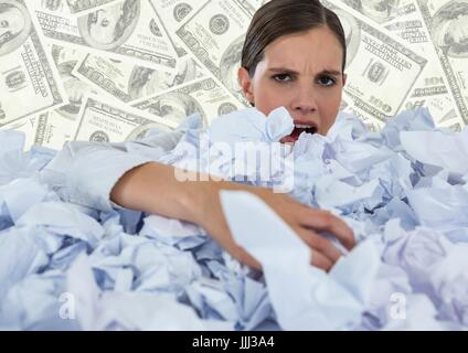 Woman covered in crumpled paper against money backdrop